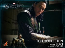 Tom Hiddleston sits with Hot Toys' Loki figure