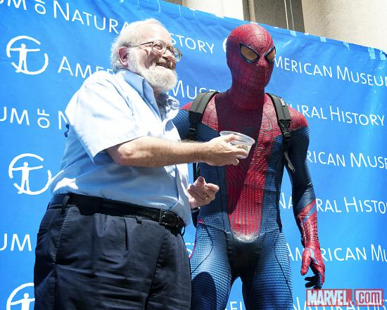 Spider-Man delivering a live Chilean rose tarantula to Norman Plotnick, curator of the exhibition Spiders Alive at the AMNH