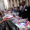 Fans recieve Captain America shields outside the NYSE. Photo By Ben Hider