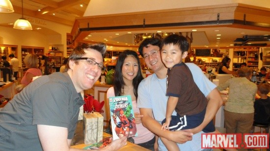 Artist Todd Nauck poses with fans