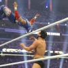Rey Mysterio delivers a moonsault to Cody Rhodes