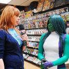 The Watcher's Lorraine Cink and She-Hulk Cosplayer at Avengers Vs X-Men Release Party at Midtown Comics