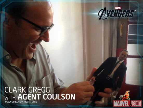 Clark Gregg inspects his likeness in the Agent Coulson figure from Hot Toys