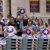 Marvel staff pose with Captain America shields outside the NYSE. Photo By Ben Hider