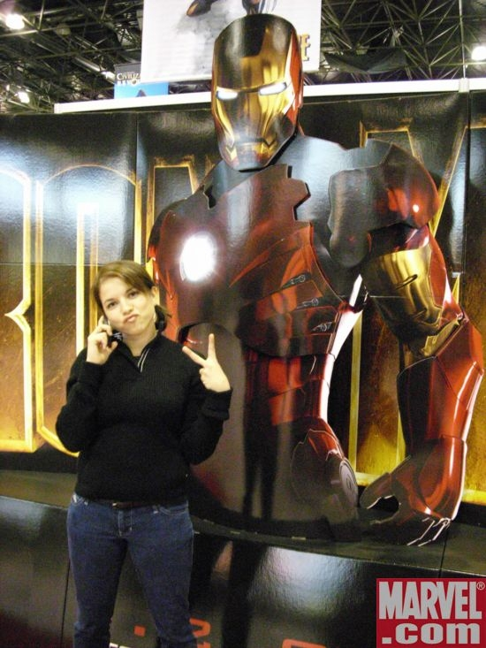 Alexa Mendez poses in front of an Iron Man standee