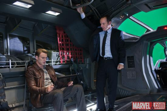 Chris Evans (Captain America) and Clark Gregg (Phil Coulson) on the set of Marvel's The Avengers