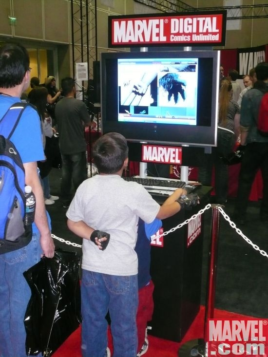 Fans enjoying Marvel Digital Comics Unlimited at the Marvel booth
