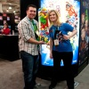 Grace Randolph, host of The Watcher, and Agent M with the Marvel Skateboard from Tokidoki and Diamond at Toy Fair 2011