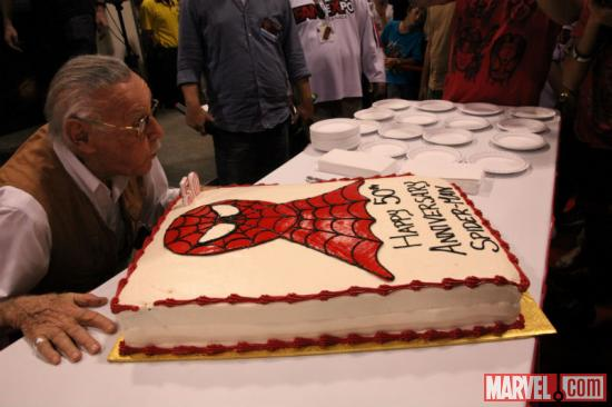 Stan Lee blowing out the candles of Spider-Man's 50th Anniversary cake at Fan Expo 2012