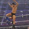 Cody Rhodes delivers a knee to the face of Rey Mysterio