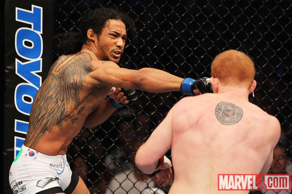 Benson Henderson fires a right cross