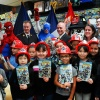 Fire Commissioner Salvatore J. Cassano, Spider-Man, Captain America, Marvel Editor Bill Rosemann, and the students of PS 51