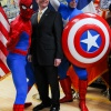 Fire Commissioner Salvatore J. Cassano with Spider-Man and Captain America