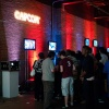 Fans crowd around a gaming station for a chance to play Ultimate Marvel Vs. Capcom 3