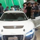 Robert Downey, Jr. on the set of Marvel's Iron Man 3 with the Audi R8 e-tron
