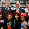 Fire Commissioner Salvatore J. Cassano with Students and a Teacher from PS 51