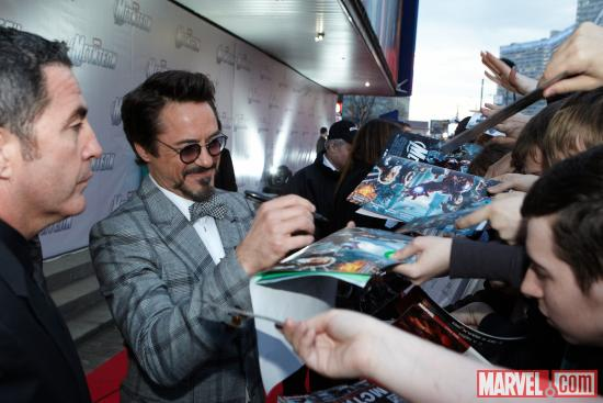Robert Downey, Jr. signing autographs at the Moscow premiere of Marvel's the Avengers