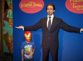 A young fan with Tony Stark's wax figure El Capitan Theatre's midnight screening of Marvel's The Avengers