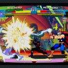 Screenshot of Thor vs. Strider Hiryu in Marvel vs. Capcom Origins