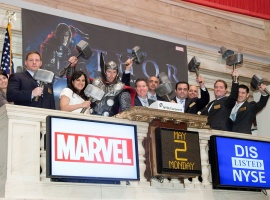 Thor and company ring the final bell at the NYSE; pictured from left: NYSE representative, Tom Marvelli (VP of Creative Services