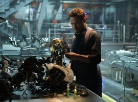 Tony Stark (Robert Downey Jr.) looks at robotic remnants in Marvel's Avengers: Age of Ultron
